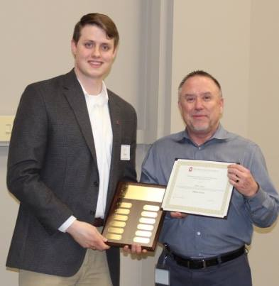 Will Evans receives the EWI Award from VP of Human Resources Mark Matson