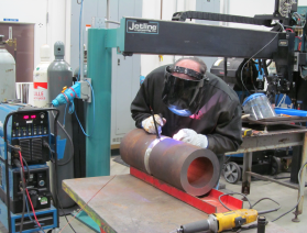 Inserting the tack welds at the weld root